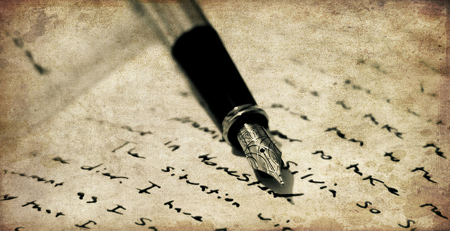 A fountain pen on a notebook.